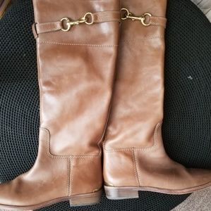 Knee length riding boots.